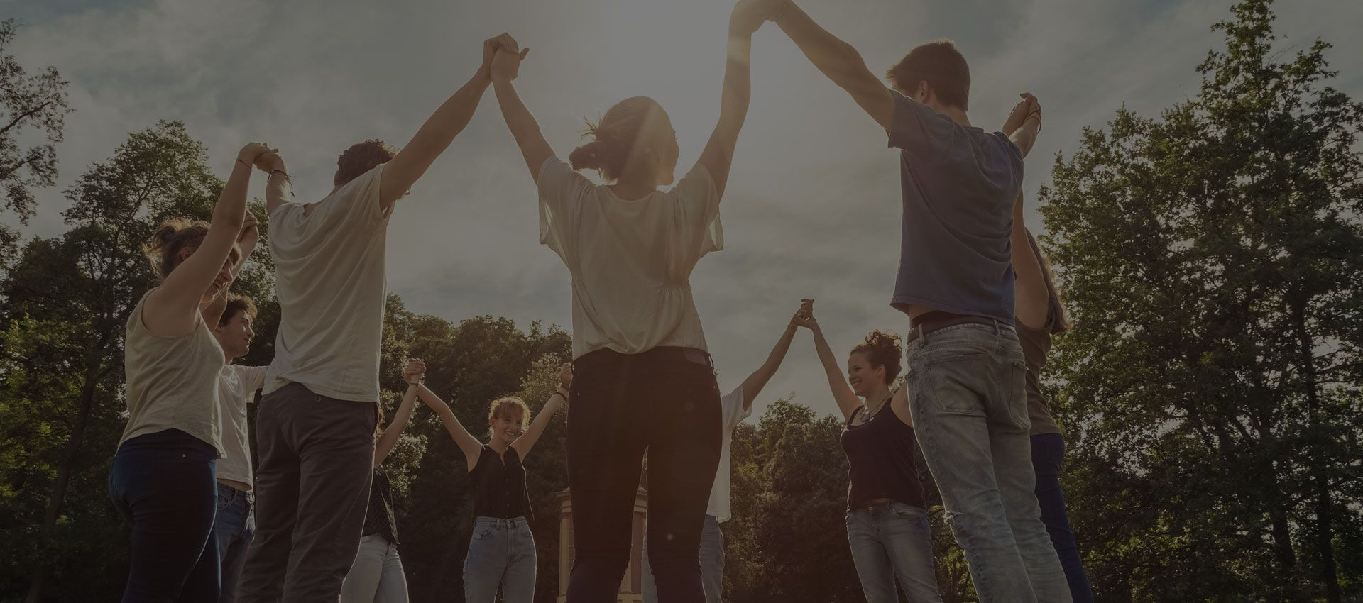Groups holding hands in the air for Alpha Center Psychological Services Grand Junction